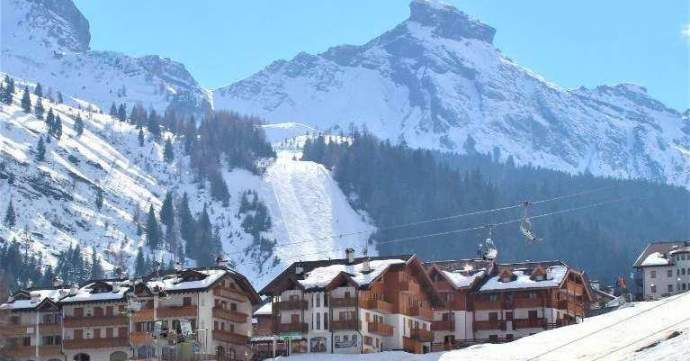 Large sunny apartment, immaculate condition, village centre, steps from ski lifts at Arabba, Dolomites in Italy